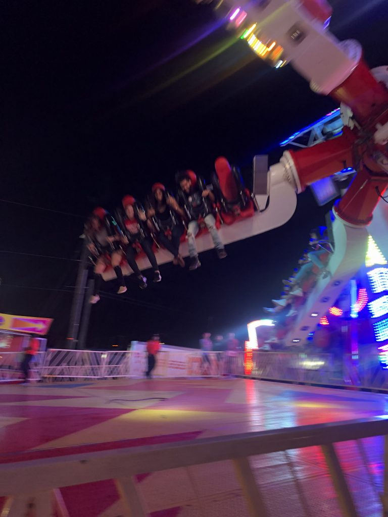 people on a Midway ride